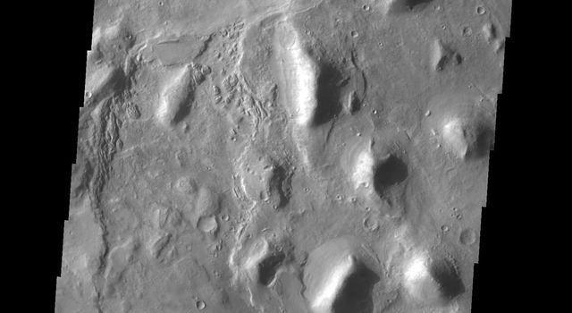 The group of hills in this image captured by NASA's 2001 Mars Odyssey spacecraft are located on the floor of a large unnamed depression in northern Arabia Terra.