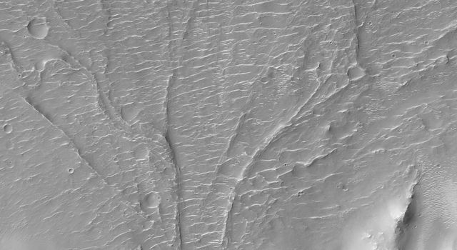 On Mars, alluvial fans are sometimes visible in impact crater basins, as material from the steep rims is transported radially inward to the relatively flat floor. This image is from NASA's Mars Reconnaissance Orbiter.