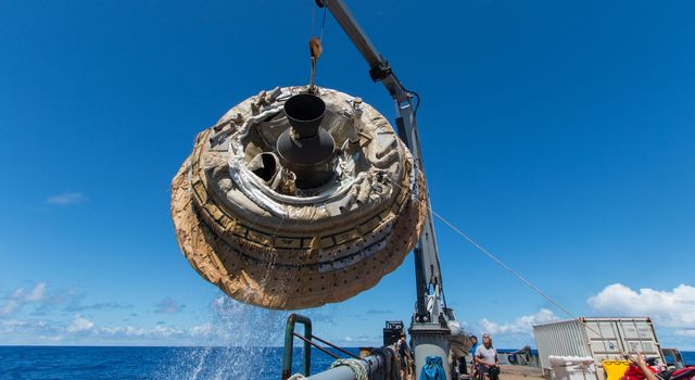 Hours after the June 28, 2014, test of NASA's Low-Density Supersonic Decelerator over the U.S. Navy's Pacific Missile Range, the saucer-shaped test vehicle is lifted aboard the Kahana recovery vessel.