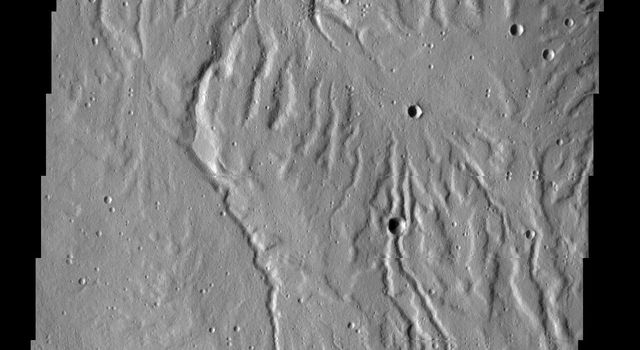 This image captured by NASA's 2001 Mars Odyssey spacecraft shows part of Rubicon Valles, a complex region of channels found on the northwestern flank of Alba Mons.