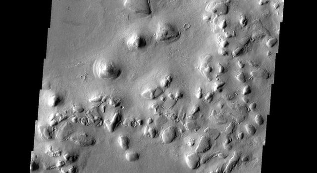 The term 'colles' means hills. The hills in this image from NASA's 2001 Mars Odyssey spacecraft are located on the northern plains near Phlegra Dorsa.