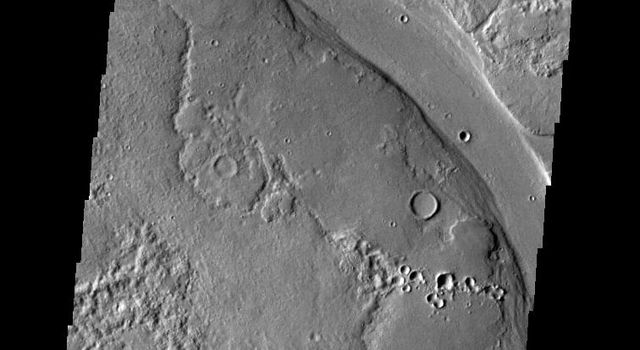 The channel in this image captured by NASA's 2001 Mars Odyssey spacecraft is a portion of Hrad Vallis.