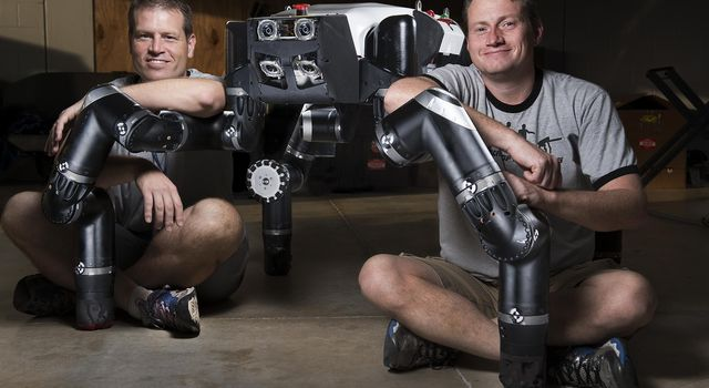 Limbed robot RoboSimian was developed at NASA's Jet Propulsion Laboratory, seen here with Brett Kennedy, supervisor of the JPL Robotic Vehicles and Manipulators Group, and Chuck Bergh, a senior engineer in JPL's Robotic Hardware Systems Group.