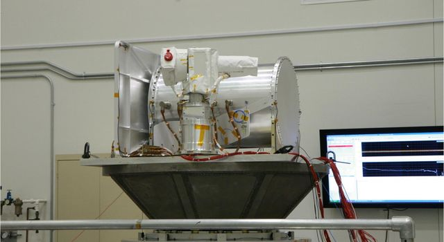 The Optical PAyload for Lasercomm Science (OPALS) undergoes vibration testing at NASa's Jet Propulsion Laboratory in December 2012.