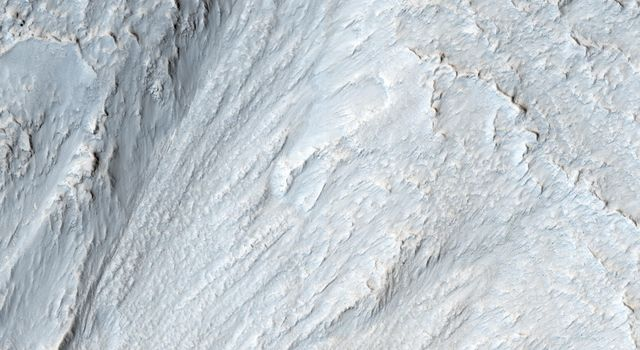 This image captured by NASA's Mars Reconnaissance Orbiter appears to show some type of mass movement of material down the wall of a mesa in Deuteronilus Mensae.
