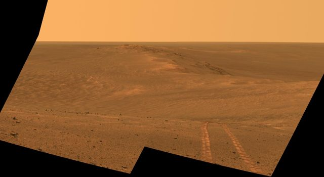 This scene from the Pancam on NASA's Mars Exploration Rover Opportunity looks back toward part of the west rim of Endeavour Crater that the rover drove along, heading southward, during the summer of 2014.