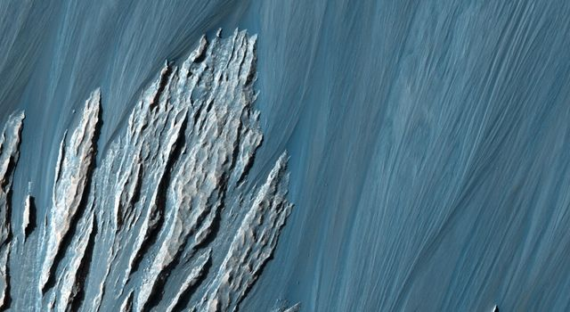 This image NASA's Mars Reconnaissance Orbitershows a prominently stratified transect through the rock of a mountain of material in the middle of Hebes Chasma.
