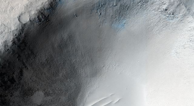 An impact crater in Isidis Planitia observed for a fifth time by NASA's Mars Reconnaissance Orbiter.