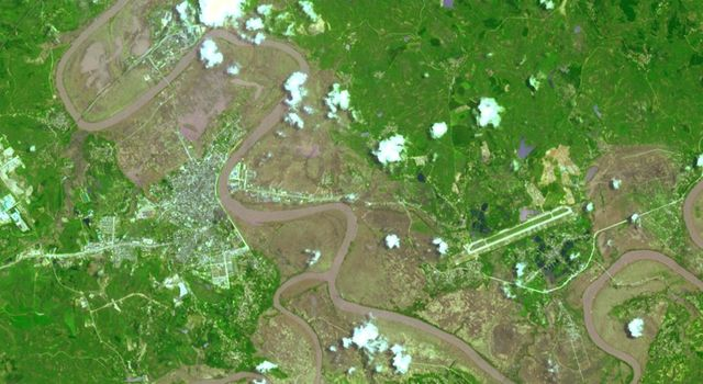 This image from the NASA's Terra spacecraft shows extensive flooding resulting from Typhoon Rammasun in Ningming, China. This ASTER image was acquired on July 24, 2014.