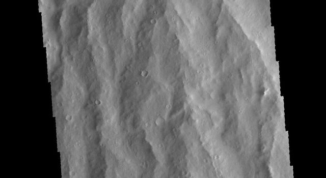 This image from NASA's 2001 Mars Odyssey spacecraft is of Apollineris Mons, which shows erosion of the materials on it's southern flank.