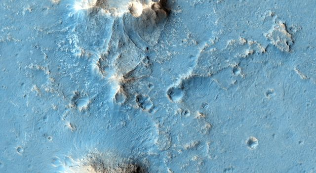 Oxia Planum is broad clay-bearing surface between Mawrth and Ares Vallis that has been proposed as a future landing site on Mars. This image is from NASA's Mars Reconnaissance Orbiter.
