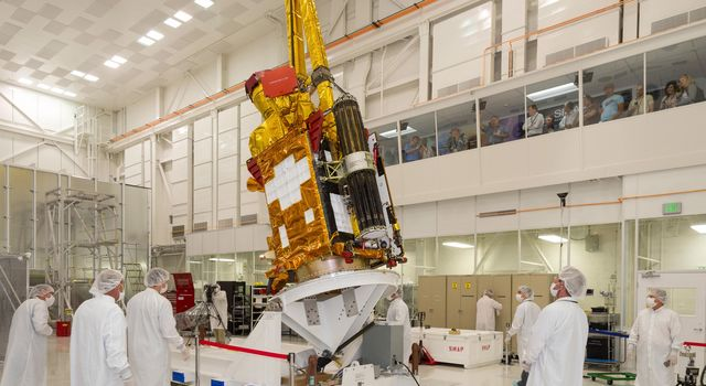 NASA's Soil Moisture Active Passive (SMAP) spacecraft is slowly lowered into place in the Spacecraft Assembly Facility at NASA's Jet Propulsion Laboratory, Pasadena, California.