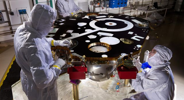 Technicians in a Lockheed Martin clean room near Denver prepare NASA's InSight Mars lander for propulsion proof and leak testing.
