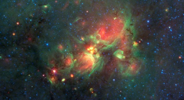 'Yellow balls' -- which are several hundred to thousands times the size of our solar system -- are pictured here in the center of this image taken by NASA's Spitzer Space Telescope.