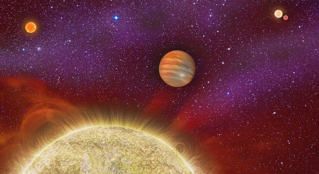 This artist's conception shows the 30 Ari system, which includes four stars and a planet. The planet, a gas giant, orbits its primary star (yellow) in about a year's time.