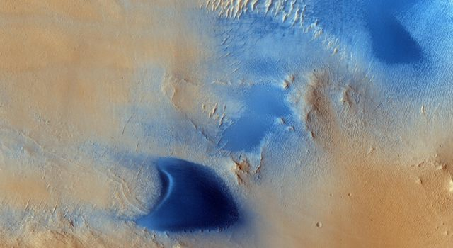 Arabia Terra is one of the more dusty regions on Mars, where ever-falling red dust covers the surface allowing only minor variations in color and tone as seen by NASA's Mars Reconnaissance Orbiter.
