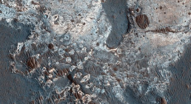 This image from NASA's Mars Reconnaissance Orbiter shows exposures of deposits along the plateau just to the south of Coprates Chasma.