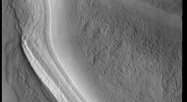 This image captured by NASA's 2001 Mars Odyssey spacecraft shows one of many troughs located on the polar cap.