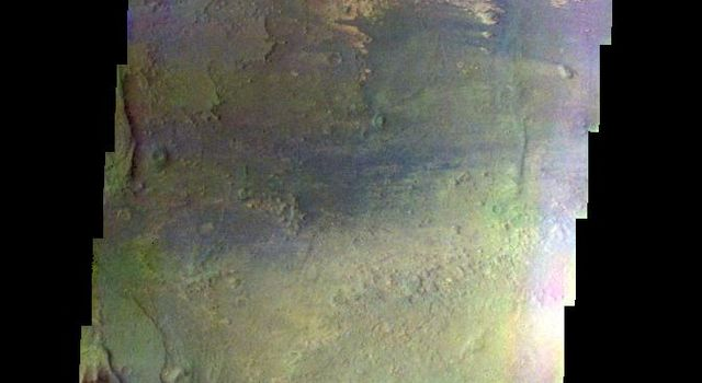 The THEMIS VIS camera contains 5 filters. The data from different filters can be combined in multiple ways to create a false color image. This false color image captured by NASA's 2001 Mars Odyssey spacecraft shows part of Melas Chasma.