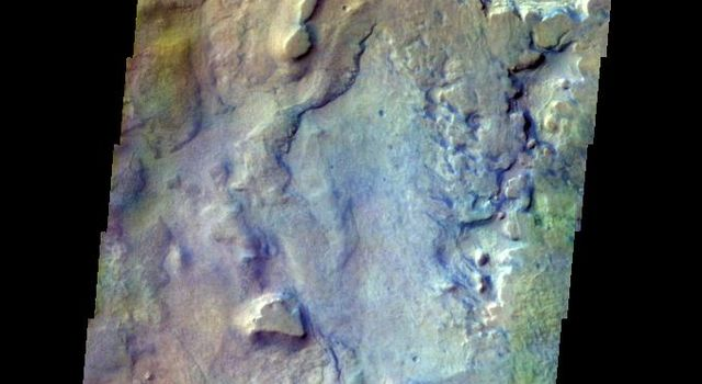 The THEMIS VIS camera contains 5 filters. The data from different filters can be combined in multiple ways to create a false color image. This false color image from NASA's 2001 Mars Odyssey spacecraft shows part of the floor of Proctor Crater.