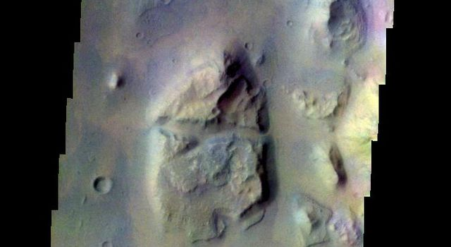 The THEMIS VIS camera contains 5 filters. The data from different filters can be combined in multiple ways to create a false color image. This false color image from NASA's 2001 Mars Odyssey spacecraft shows part of of Eos Chasma.