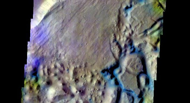 The THEMIS VIS camera contains 5 filters. The data from different filters can be combined to create a false color image. This false color image from NASA's 2001 Mars Odyssey spacecraft shows part of a tributary channel that empties into Ares Vallis.