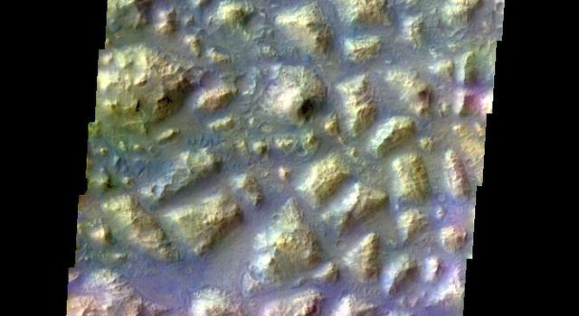 The THEMIS VIS camera contains 5 filters. The data from different filters can be combined in multiple ways to create a false color image. This false color image from NASA's 2001 Mars Odyssey spacecraft shows part of Atlantis Chaos.