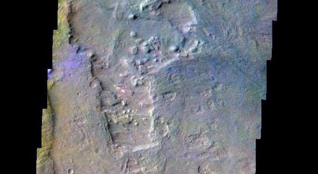 The THEMIS VIS camera contains 5 filters. The data from different filters can be combined in multiple ways to create a false color image. This false color image from NASA's 2001 Mars Odyssey spacecraft shows part of Coprates Chasma.