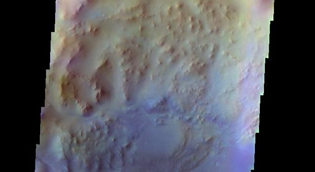 The THEMIS VIS camera contains 5 filters. The data from different filters can be combined in multiple ways to create a false color image. This false color image from NASA's 2001 Mars Odyssey spacecraft shows part of Hargraves Crater.