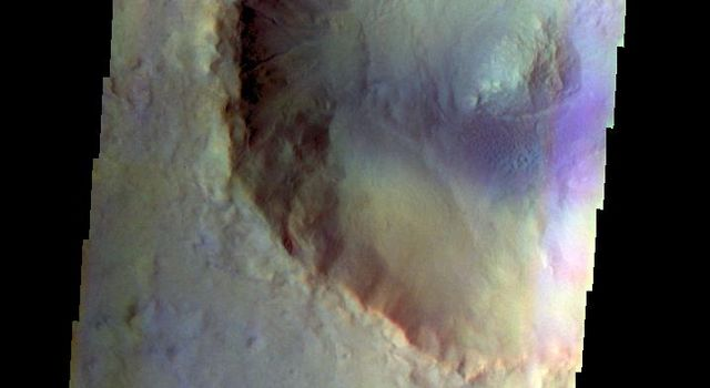 The THEMIS VIS camera contains 5 filters. The data from different filters can be combined in multiple ways to create a false color image. This false color image from NASA's 2001 Mars Odyssey spacecraft shows an unnamed crater in Acidalia Planitia.