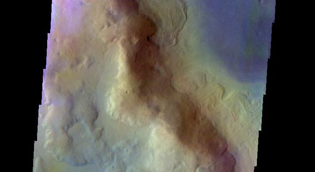 The THEMIS VIS camera contains 5 filters. The data from different filters can be combined in multiple ways to create a false color image. This false color image from NASA's 2001 Mars Odyssey spacecraft shows part of Renaudot Crater.