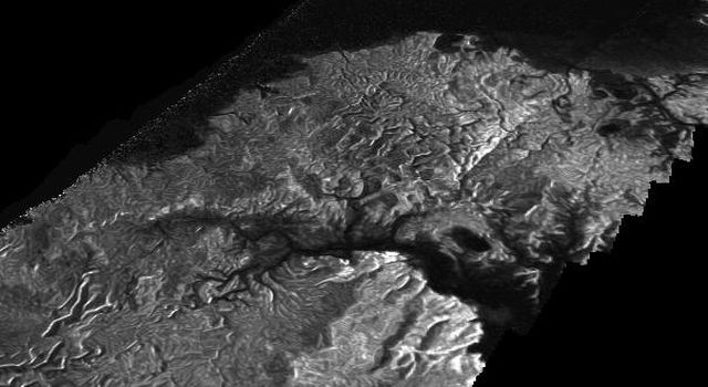 NASA's Cassini Synthetic Aperture Radar (SAR) image is presented as a perspective view and shows a landscape near the eastern shoreline of Kraken Mare, a hydrocarbon sea in Titan's north polar region.