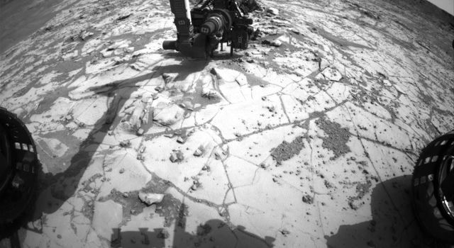 This view NASA's Curiosity Mars Rover shows the rover's drill in position for a mini-drill test to assess whether a rock target called 'Mojave' is appropriate for full-depth drilling to collect a sample. It was taken on Jan. 13, 2015.