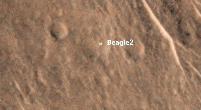NASA's Mars Reconnaissance Orbiter shows a bright feature interpreted as the United Kingdom's Beagle 2 Lander, which was never heard from after its expected December 25, 2003, landing.