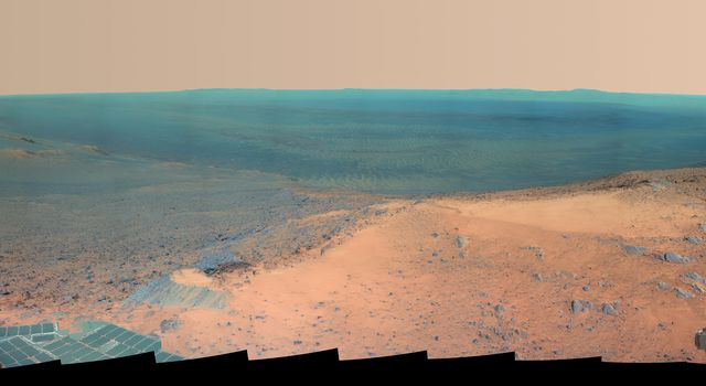 NASA's Mars Exploration Rover Opportunity obtained this view from the top of the 'Cape Tribulation' segment of the rim of Endeavour Crater. The rover reached this point three weeks before the 11th anniversary of its January 2004 landing on Mars.