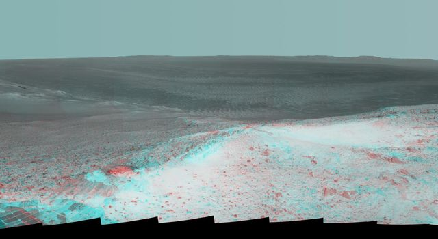 NASA's Mars Exploration Rover Opportunity gained this stereo vista from the top of a raised segment of the rim of Endeavour Crater. The view appears three-dimensional when seen through 3D glasses with red lens on the left.