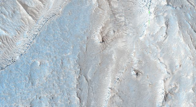 The image from NASA's Mars Reconnaissance Orbiter is approximately 6 by 6 kilometers and is located east of Noctis Labyrinthus, in a portion the large canyon system Valles Marineris.