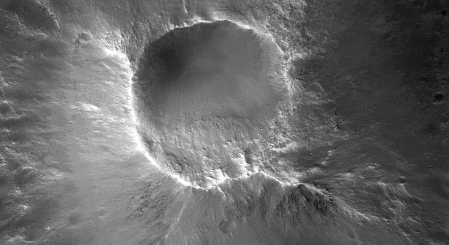 There are many knob formations is the southeastern Acidalia region of Mars. All show a hilltop crest except one which has a summit crater that resembles a cone volcano in this image captured by NASA's Mars Reconnaissance Orbiter.