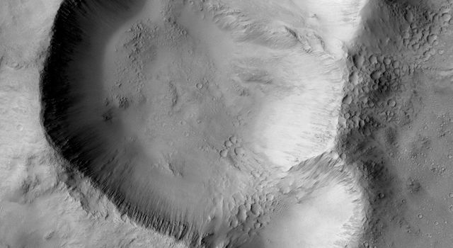 This image from NASA's Mars Mars Reconnaissance Orbiter shows a triple impact crater in Elysium Planitia near Tartarus Montes, which probably formed when a binary-or even triple-asteroid struck the surface.