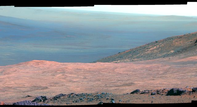 This false color view from NASA's Mars Exploration Rover Opportunity shows part of 'Marathon Valley,' a destination on the western rim of Endeavour Crater, as seen from an overlook north of the valley.