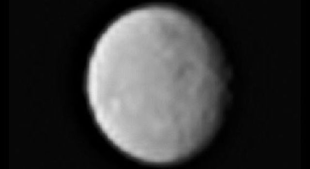 This processed image, taken Jan. 13, 2015, shows the dwarf planet Ceres as seen from the Dawn spacecraft. The image hints at craters on the surface of Ceres. Dawn's framing camera took this image at 238,000 miles (383,000 kilometers) from Ceres.