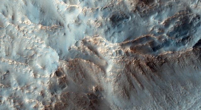 NASA's Mars Reconnaissance Orbiter observes the southeast rim of Hale Crater, about 150 kilometers (90 miles) in diameter and located in the mid-southern latitudes just north of the massive Argyre basin.