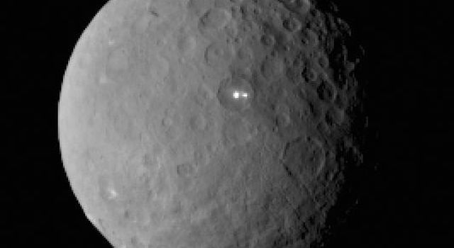 This image was taken by NASA's Dawn spacecraft of dwarf planet Ceres on Feb. 19 from a distance of nearly 29,000 miles (46,000 kilometers). It shows that the brightest spot on Ceres has a dimmer companion, which apparently lies in the same basin.
