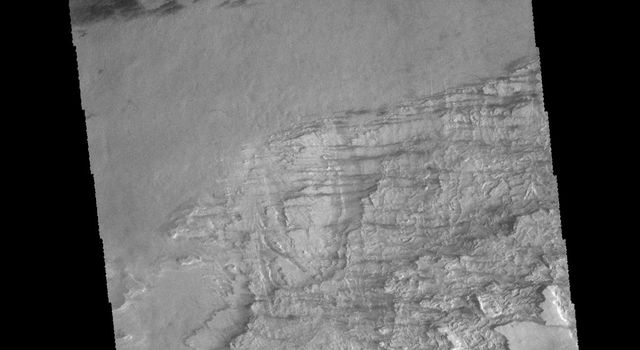 The unusual texture seen in this image of Galle Crater is likely layered deposits that have been eroded. Small dune and windstreak features in this image from NASA's 2001 Mars Odyssey spacecraft, indicate that winds are part of the erosive process.