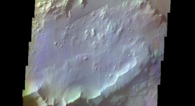 The THEMIS VIS camera contains 5 filters. The data from different filters can be combined in multiple ways to create a false color image. This false color image from NASA's 2001 Mars Odyssey spacecraft shows part of Ganges Chasma.
