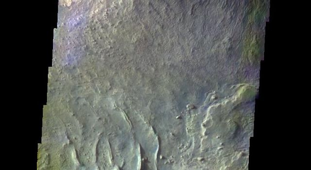 The THEMIS VIS camera contains 5 filters. The data from different filters can be combined in multiple ways to create a false color image. This false color image from NASA's 2001 Mars Odyssey spacecraft shows part of Ceti Mensa in Candor Chasma.