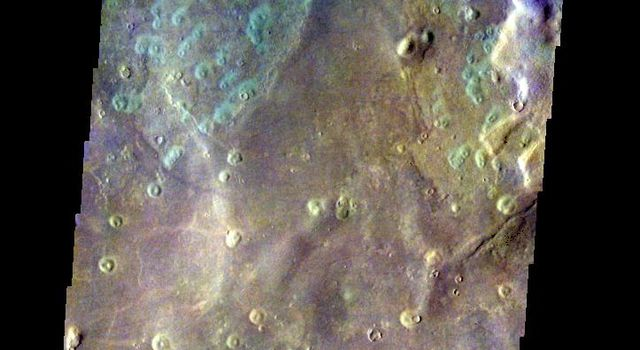 The THEMIS VIS camera contains 5 filters. The data from different filters can be combined in multiple ways to create a false color image. This false color image from NASA's 2001 Mars Odyssey spacecraft shows part of Acidalia Planitia.