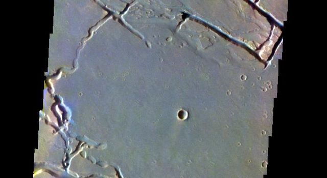 The THEMIS VIS camera contains 5 filters. The data from different filters can be combined in multiple ways to create a false color image. This false color image from NASA's 2001 Mars Odyssey spacecraft shows part of Granicus Valles.
