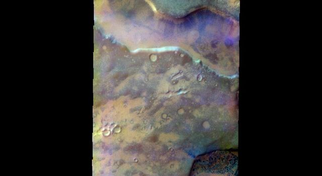 The THEMIS VIS camera contains 5 filters. The data from different filters can be combined in multiple ways to create a false color image. This image from NASA's 2001 Mars Odyssey spacecraft shows depressions in the surface of southern Noachis Terra.