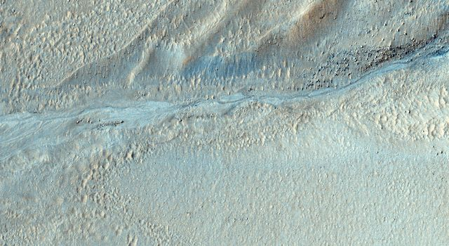 This image from NASA's Mars Reconnaissance Orbiter shows several seemingly active gullies and their associated fans near the Argyre region.